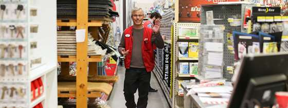 A hardware store employee waves