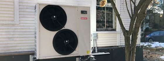 Image of an outdoor heat pump unit.