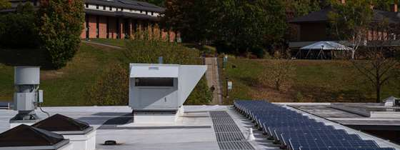 The rooftop units on the MacFarlane Building, next to the solar panels