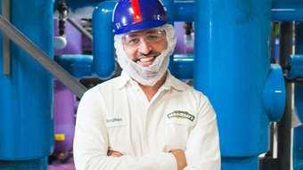 A man in health and safety gear smiles