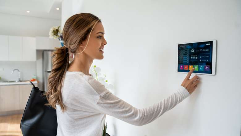 Image of woman adjusting controls for her smart home