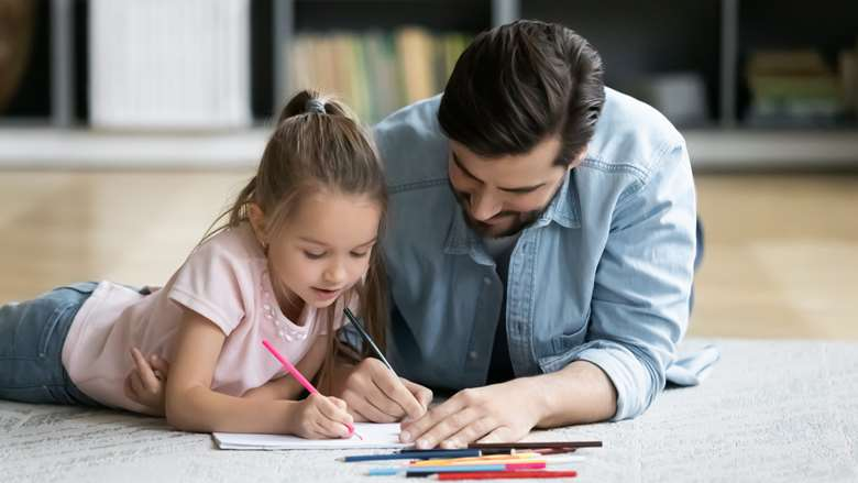 Parent and child coloring together