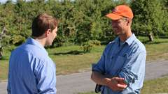 Champlain Orchards owner, Bill Suhr discusses energy savings with Efficiency Vermont's Ethan Bellevance