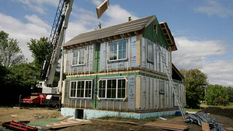 photo of a house being buit, shows no siding and a work in progress