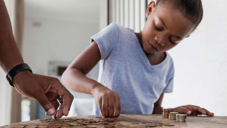 photo of young girl counting coins