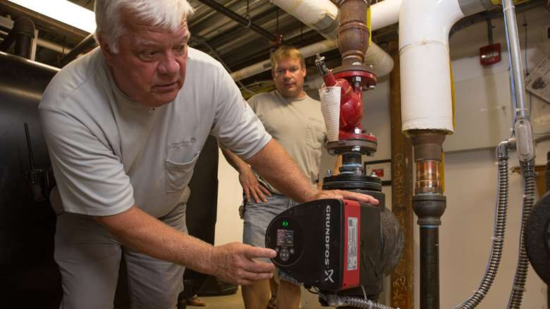 Two men making energy efficiency improvements at Bennington College