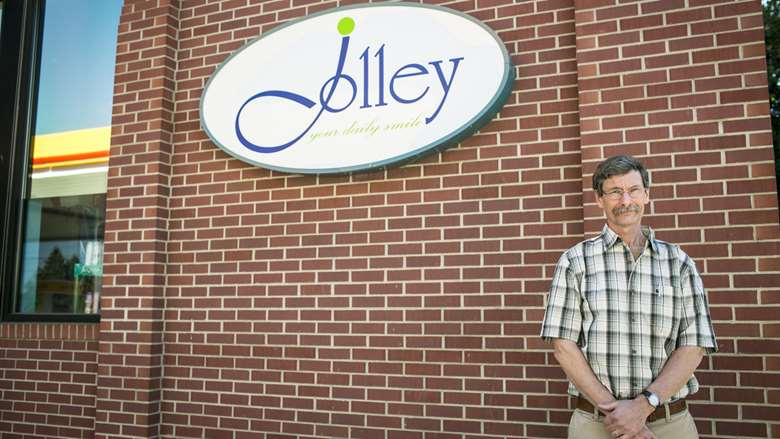The property manager outside Jolley convenience store