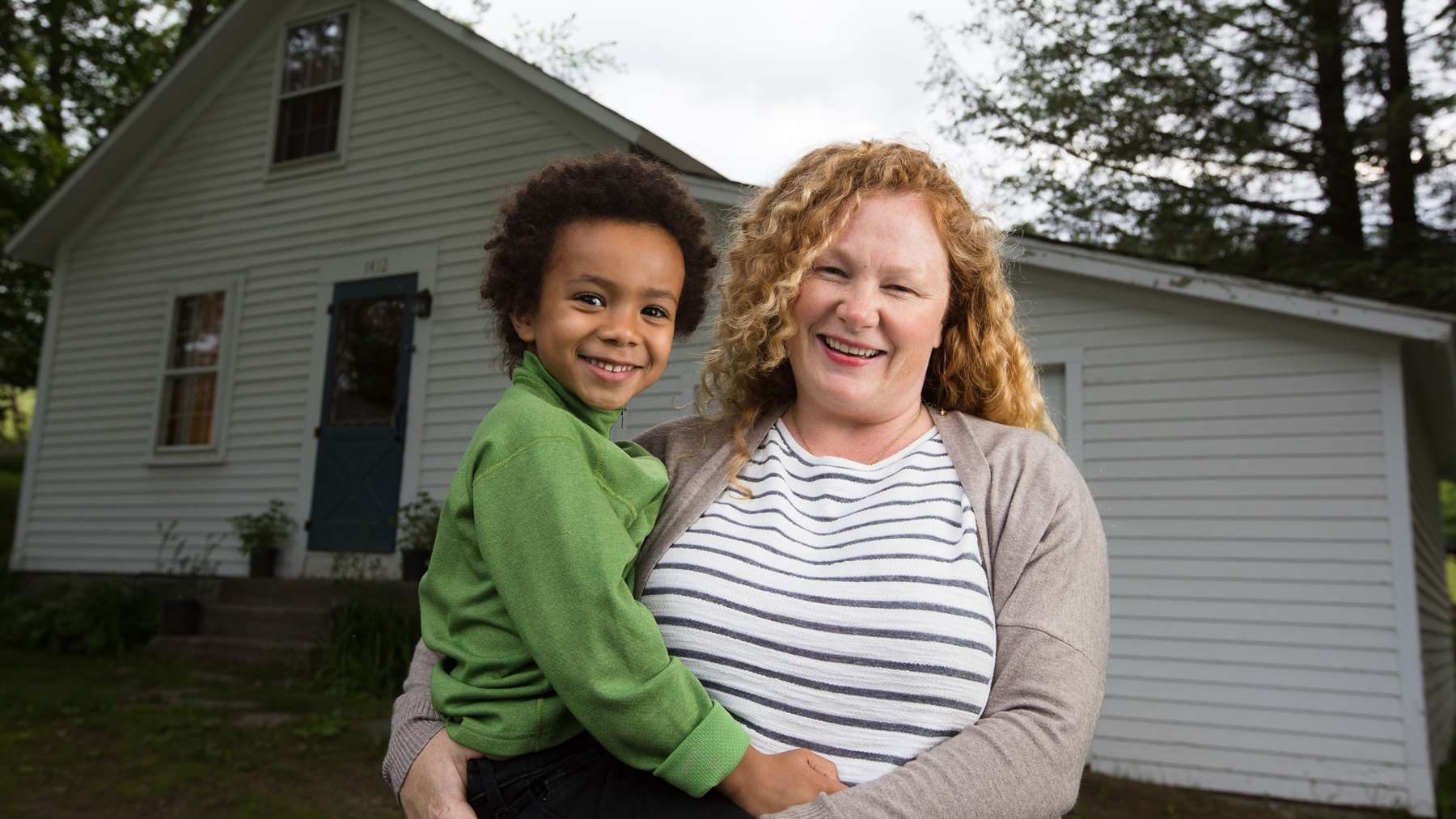 Kelsey Burns and her son at their cozy, healthy Guilford home