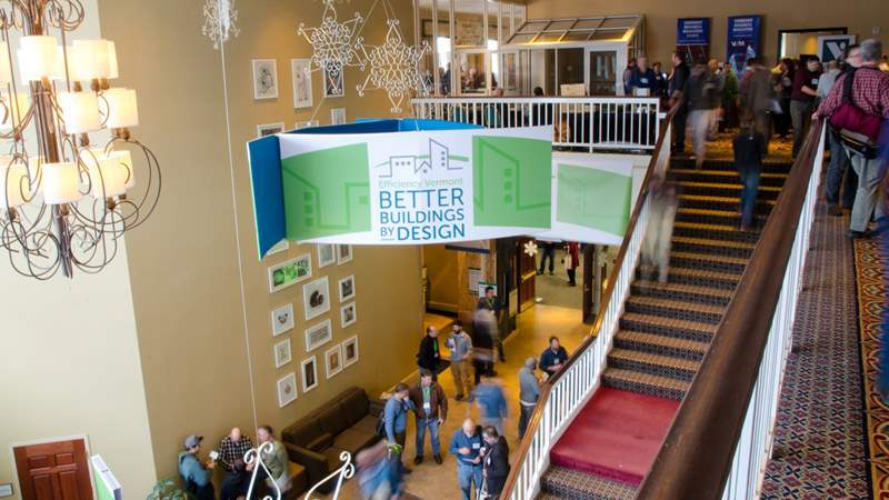 Photo of attendees in the lobby of Better Buildings by Design